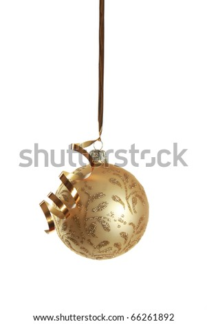 Golden christmas ball hanging on ribbon isolated over white - stock photo