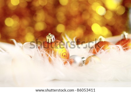 golden christmas ball on a furry background, christmas balls - stock photo