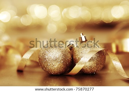 golden christmas ball on golden bokeh background - stock photo