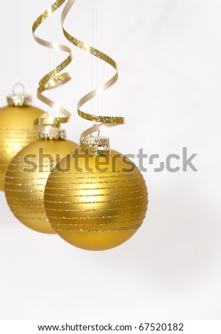 Golden christmas ball on white background - stock photo