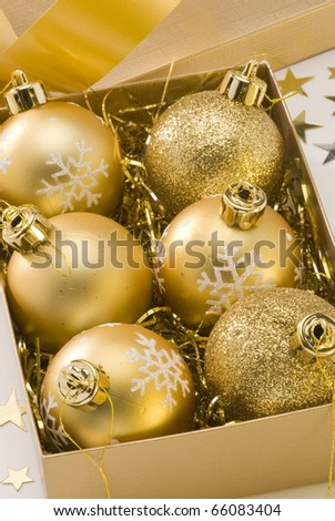 Golden Christmas balls in a gift box.White background.