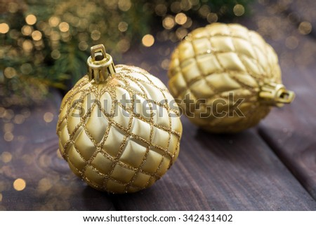 Golden Christmas balls on the background of fir branches, closeup, horizontal - stock photo