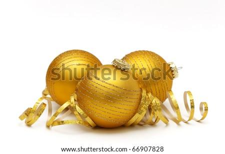 Golden christmas balls over white background - stock photo