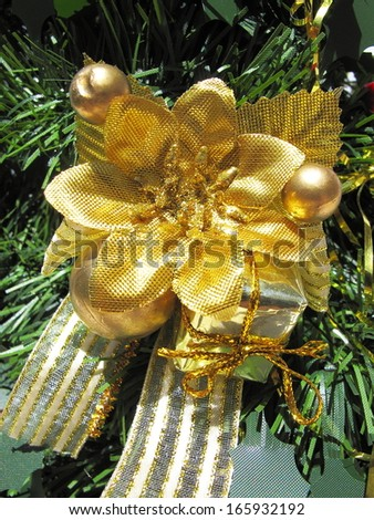 golden Christmas decoration on Christmas tree - stock photo