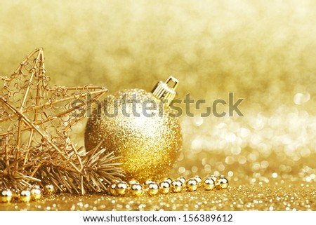 Golden christmas decoration on glitter background