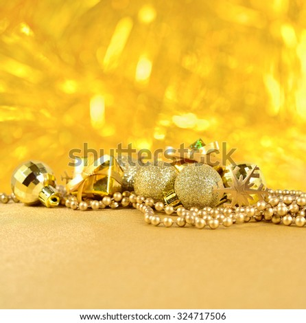 Golden Christmas decorations on a golden background
