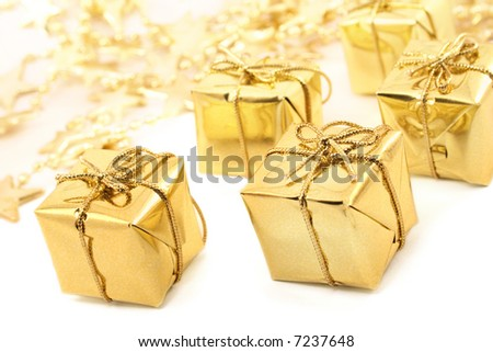 Golden christmas gift boxes isolated - stock photo