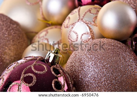 Golden Christmas ornaments background.