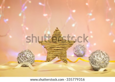 Golden Christmas star decoration with silver balls on bokeh background - stock photo