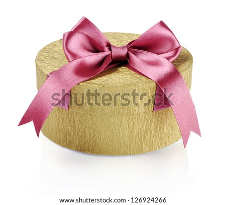 Golden circle gift box with pink ribbon over white background. Clipping path included. - stock photo