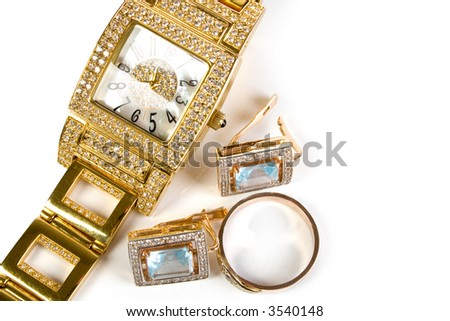 Golden clock and jewelery. Isolate on white background.