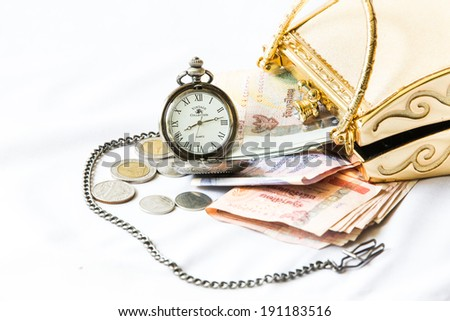 Golden clutch ,money and  vintage pocket watch ,Time and financial concept. - stock photo