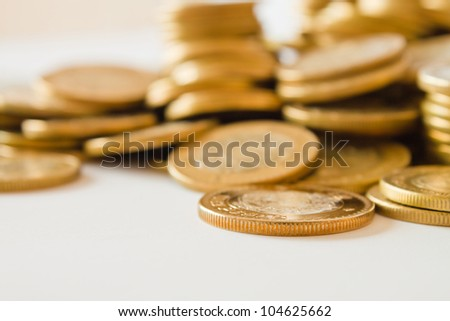 golden coins close up, mexican ten pesos coins - stock photo