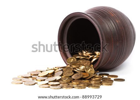 Golden coins falling out from pot on white background