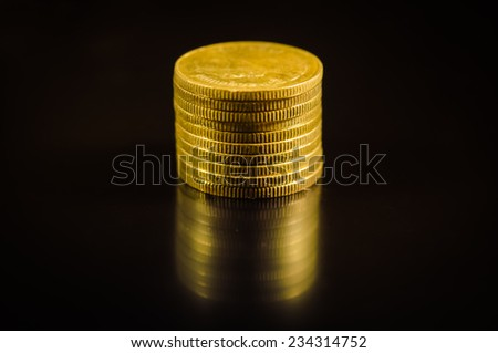 Golden coins on black background. - stock photo