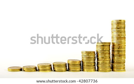 Golden coins towers, metaphor for exponential strong growth - stock photo