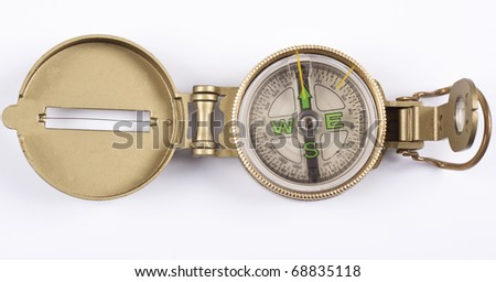 golden compass pointing north on white background - stock photo