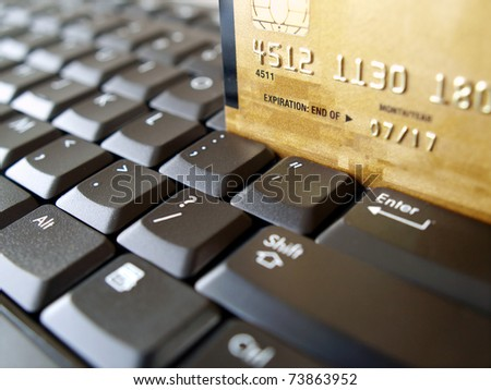 Golden credit card on computer keyboard. - stock photo