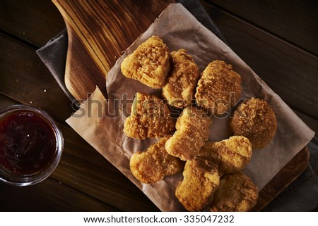 golden crispy homemade chicken nuggets from overhead top down view - stock photo