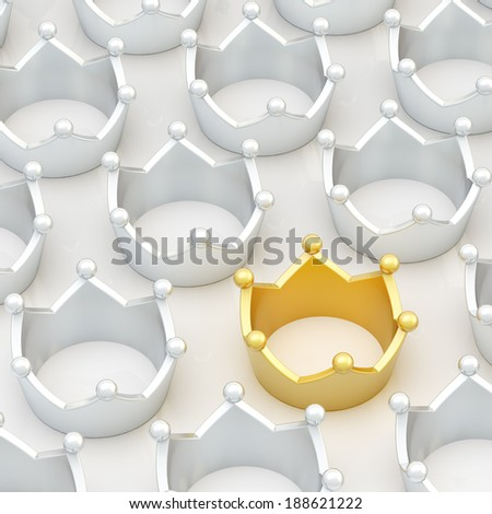 Golden crown among silver ones as a conceptual leadership background composition - stock photo