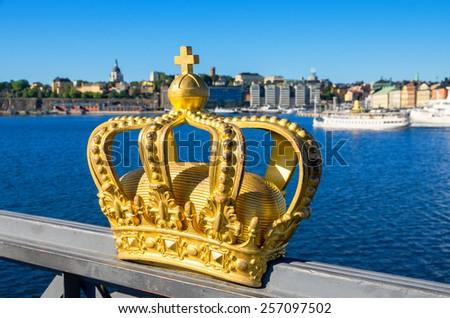 Golden crown on Skeppsholmsbron bridge. Stockholm, Sweden, Scandinavia, Europe - stock photo