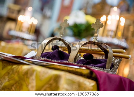 Golden crowns in orthodox wedding ceremony - stock photo
