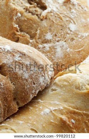 Golden crusty French breads fresh from the bakery - stock photo