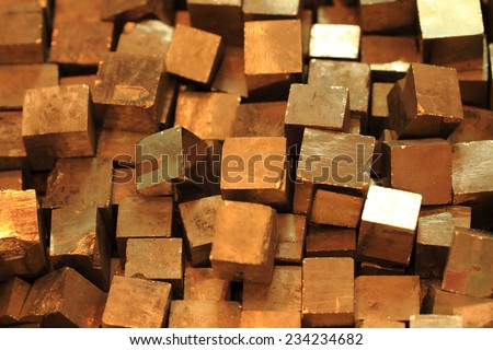 golden cubes (pyrite mineral) as nice background - stock photo