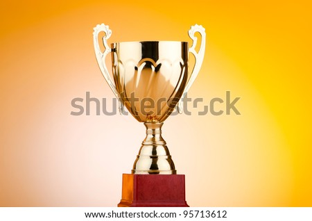 Golden cup against the background - stock photo
