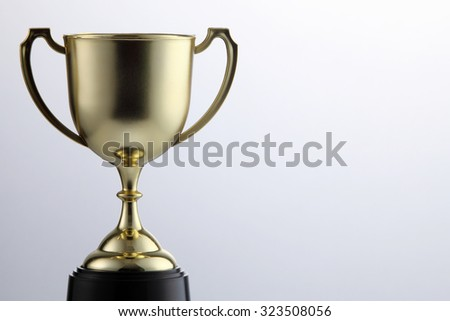 golden cup trophy isolated on white background - stock photo
