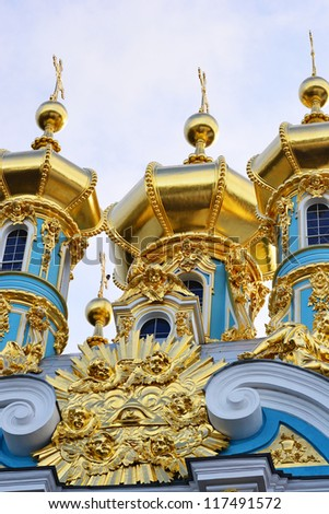 Golden cupolas of Catherine Palace church on the sky background - stock photo