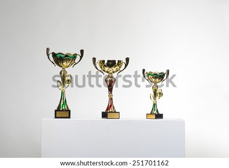 Golden cups of the winner - stock photo