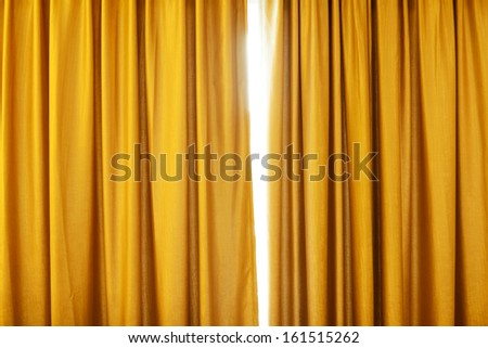 Golden curtain background with folds - stock photo