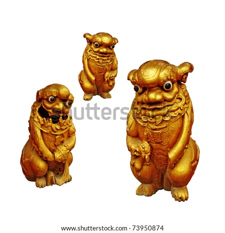 Golden cute mythological figurine used to guard Oriental temple isolated against white background. - stock photo