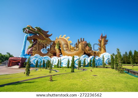 golden dargon statue at suphanburi , Thailand - stock photo