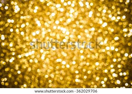 Golden defocused glitter background. - stock photo