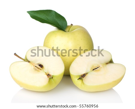 Golden Delicious apples with one sliced in half - stock photo