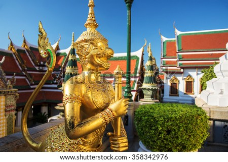 Golden Demon Guardian at Wat Phra Kaew, Temple of the Emerald Buddha, Bangkok, Thailand - stock photo