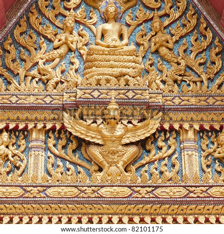 Golden detailed decor on the side of thai buddhist temple. Hua Hin, Thailand.