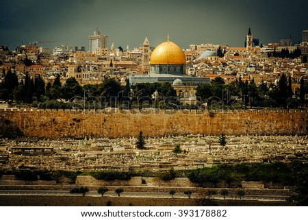 golden Dome of the Rock and church steeples on the skyline of the Old City of Jerusalem. - stock photo