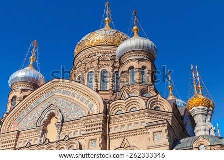 Golden domes of Assumption Church on Vasilevsky Island. Orthodox church in Saint-Petersburg, Russia - stock photo