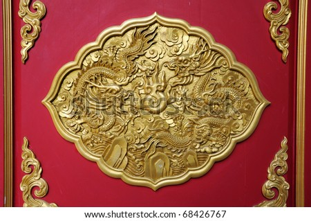 Golden dragon decorated on red wood,chinese style ,temple in Thailand - stock photo