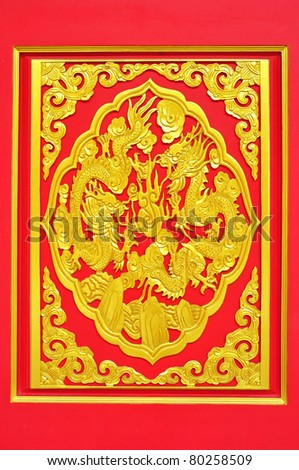 golden dragon decorated on red wood in chinese temple,Nonthaburi Province,Thailand