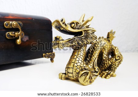 Golden dragon figurine on the table - stock photo