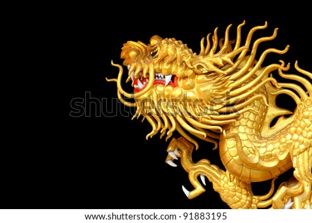 Golden Dragon sculpture with isolated back background - stock photo