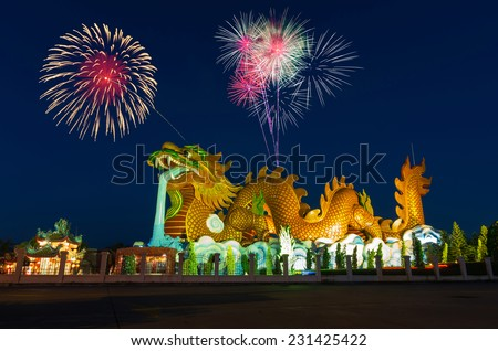 Golden Dragon with fireworks at Suphanburi, Thailand, Public architecture for travel - stock photo