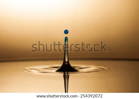 Golden drop of water - stock photo