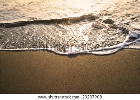 golden dusk at the beach. lanzarote island - stock photo