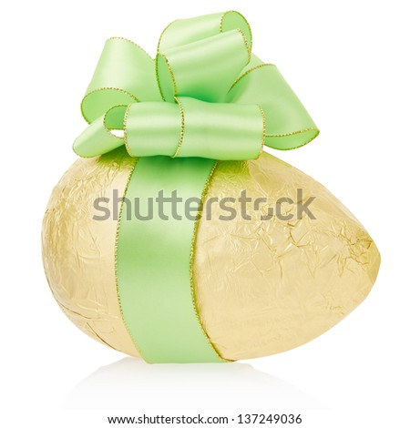Golden Easter egg with bow isolated on white, clipping path included - stock photo