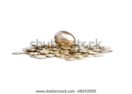 golden egg and coins - stock photo